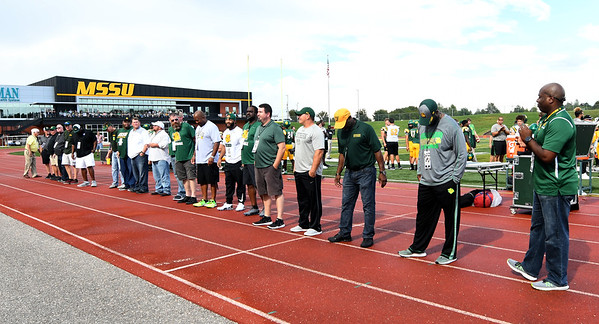 Members of the Missouri Southern 1993 MIAA Championship team are introduced on Saturday at Fred G. Hughes Stadium.<br /> Globe | Laurie Sisk