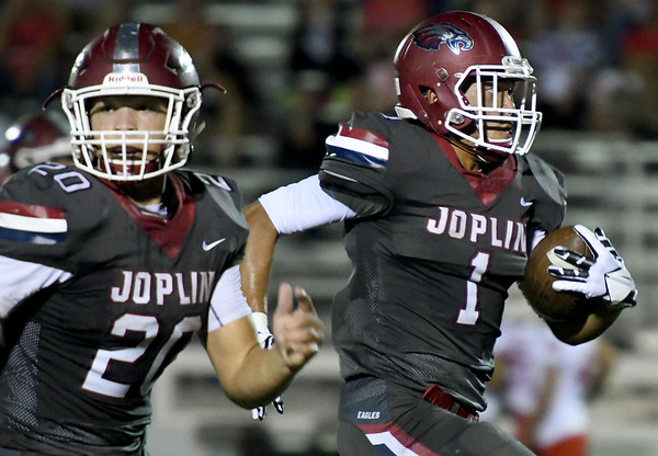 Joplin's Zach Westmoreland (1) gets an escort into the endzone courtesy of  teammate Isaiah Davis (20) during their game on Friday night at Junge Field.<br /> Globe | Laurie Sisk