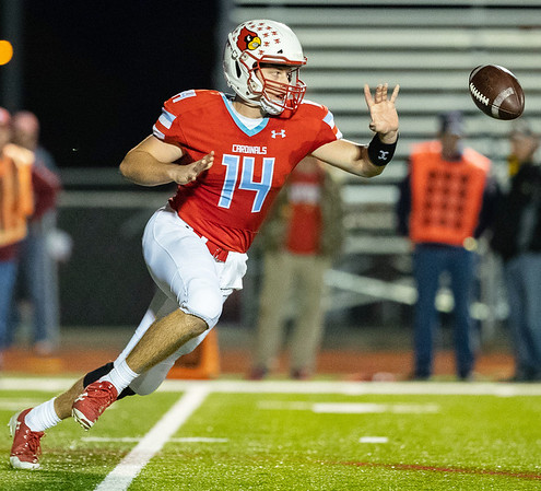 Cardinal's Quarterback Cade Beason throws a short pass to Kane Parks #42 (not in photo) during their Class 4 District 6 game against McDonald Co. on Friday night at Cardinal Stadium.<br /> Globe   Israel Perez