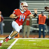 Cardinal's Quarterback Cade Beason throws a short pass to Kane Parks #42 (not in photo) during their Class 4 District 6 game against McDonald Co. on Friday night at Cardinal Stadium.<br /> Globe | Israel Perez