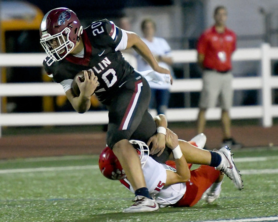 Joplin's Isaiah Davis (20)  of Ozark's Colton Casteel (15)) during their game on Friday night at Junge Field.<br /> Globe | Laurie Sisk