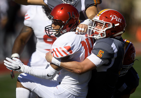 Pittsburg State's Carter Anchors (5) brings down Central Missouri's Zion Perry (14) during their game on Saturday at Carnie Smith Stadium.<br /> Globe   Laurie Sisk