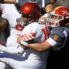 Pittsburg State's Carter Anchors (5) brings down Central Missouri's Zion Perry (14) during their game on Saturday at Carnie Smith Stadium.<br /> Globe | Laurie Sisk