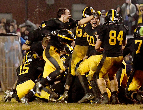 Cassville players celebrate their win over Lama on Friday night at Cassville.<br /> Globe | Laurie Sisk