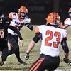 Neosho's Gage Kelly runs through the Republic defense, includingTyler Tolmasoff (43), Nolan white (23) and Casey Peltz (33) during Friday's game in Neosho.<br /> Globe | Willie Brown