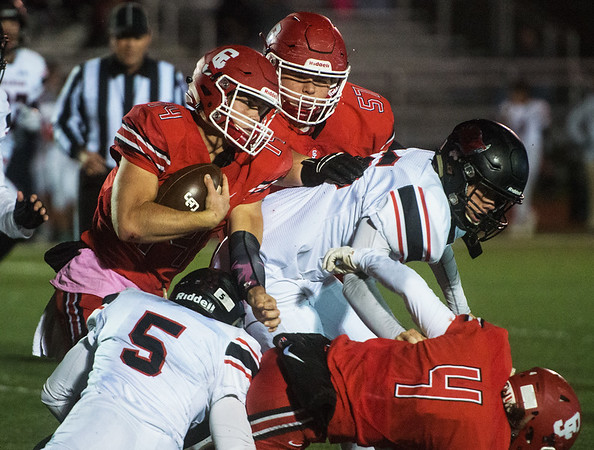With blocks from Carl Junction's Kobe Maxwell (4) and Ethan Howard (57), Joe Kennedy runs the ball against Branson on Friday at Carl Junction.<br /> Globe   Roger Nomer