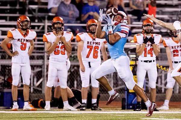 Globe | Israel Perez<br /> Webb City's Terrell Kabala (1) makes an 80 yard touchdown pass against Republic during their game on Friday night at Cardinal Stadium.