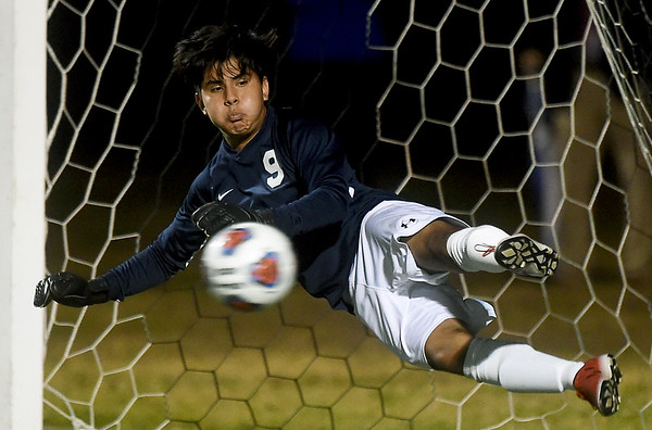 Joplin goal keeper Juan Cornelio tries to knock down a penalty kick in overtime during the Eagles Class 4 District 11 semifinal win over Republic on Tuesday at JHS.<br /> Globe | Laurie Sisk