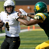 Missouri Westernquarterback Dom Marino (4) looks to get past Missouri Southern's Alan Glanville (31) during their game on Saturday at Fred G. Hughes Stadium. <br /> Globe | Laurie Sisk