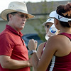 Joplin tennis coach Ed Ingle strategizes with his doubles team of Ashley Butler, center, and Astrid Cardenas during a match against Carthage last week at JHS.<br /> Globe | Laurie Sisk