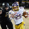 Monett's Ethan Umfleet runs with the ball as Neosho's Tre'Von Letts chases during Friday's game in Neosho.<br /> Globe | Willie Brown