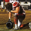 Lamar senior Caleb Gouge kneels at midfield after the Tigers' natin-best win streak comes to an end at the hands of Cassville on Friday night at Cassville.<br /> Globe | Laurie Sisk