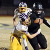 Monett's Dale Sadler tries to tackle Neosho's Drayke Perry during Friday's game in Neosho.<br /> Globe | Willie Brown