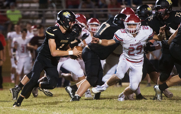 Neosho's Gage Kelley finds running room past Isiac Shields during Friday's game at Neosho.<br /> Globe | Roger Nomer
