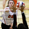 Carl Junction hitter Salma Lewis (26) gets a spike past Springfield Central blocker Jaley Rice during their match on Saturday at the Dr. Jeffrey Knutzen CJ Classic Volleyball Tournament at CJHS.<br /> Globe   Laurie Sisk