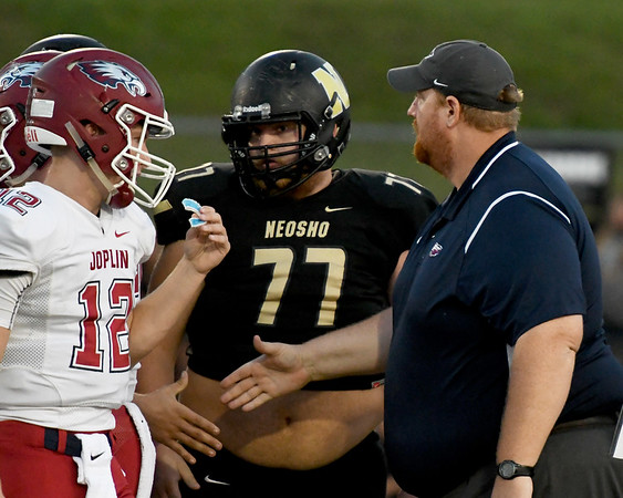 Joplin coach Curtis Jasper greets Neosho players before the start of the Eagles game against Neosho on Friday night at Neosho.<br /> Globe | Laurie Sisk