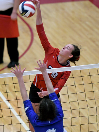 Carl Junction's Grace Southern (29) gets a kill as Carthage's Riley Kabance blocks during their Class 4 District 11 championship on Thursday at Joplin High School.<br /> Globe | Laurie Sisk