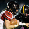 Lamar's Duncan Gepner (6) works to get past Cassville's Jacob Olbertz (54) during their game on Friday night at Cassville.<br /> Globe | Laurie Sisk
