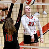 Carl Junction hitter Jillian Kennedy (21) gets a spike past Springfield Central blocker Maddie Dimmick during their match on Saturday at the Dr. Jeffrey Knutzen CJ Classic Volleyball Tournament at CJHS.<br /> Globe   Laurie Sisk