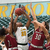 Missouri Southern's Chasidee Owens goes up for a shot in between Henderson State's Pink Jones (2) and Karrington Whaley (30) during Friday's game at the Leggett and Platt Athletic Center.<br /> Globe | Roger Nomer