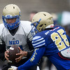 Northeastern Oklahoma A&M quarterback Guy Myers (14) hands off to Darran Williams (25) during practice on Wednesday at NEO.<br /> Globe   Laurie Sisk