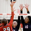 Carl Junction's Grace Southern (29) gets a spike past Joplin blockers Addison Saunders (12) and Malia Mack (10) during their match on Tuesday night at CJHS.<br /> Globe | Laurie Sisk
