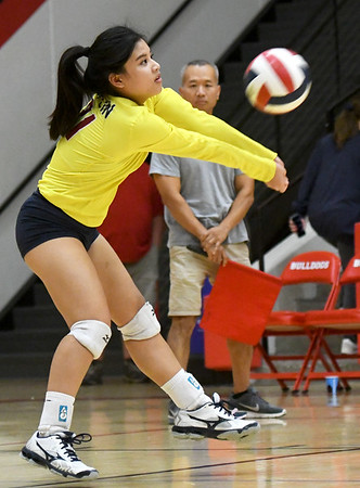 Joplin libero Jeanie Juneweeranong (31) returns a spike during the Eagles' match against Carl Junction on Tuesday night at CJHS.<br /> Globe | Laurie Sisk