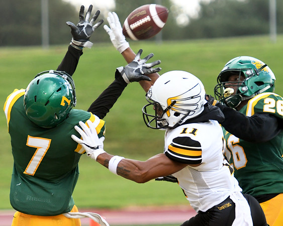 Missouri Southern's Korenzo Credit (7) intercepts a pass in the endzone intended for Missouri Western's Joe Horn Jr. (11) during their game on Saturday at Fred G. Hughes Stadium. Also pictured is MSSU defensive back John Ejizu (26.)<br /> Globe | Laurie Sisk