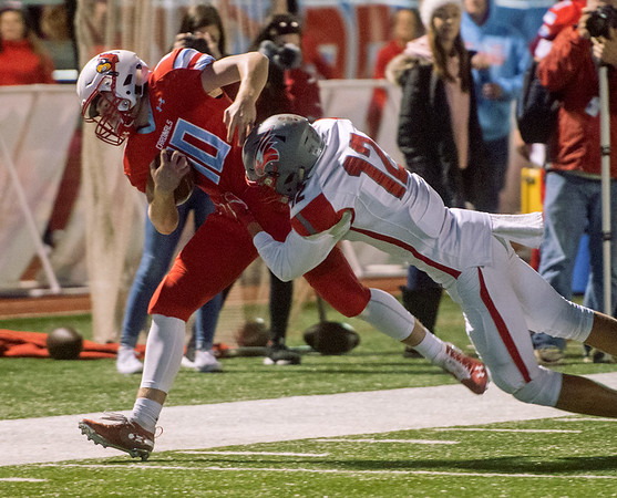 Webb City's Cole Gayman makes a first down off of a faked punt as he is hit by Nixa's Lukas Roemen during Friday's game in Webb City.<br /> Globe | Roger Nomer