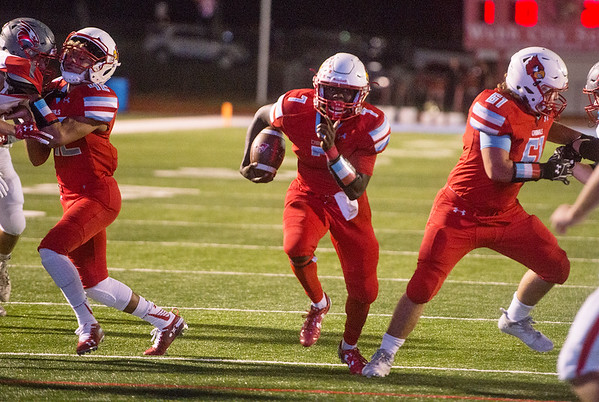 Webb City's Durand Henderson finds a hole created by Kane Parks (42) and Matt Miller (61) to score against Nixa on Friday in Webb City.<br /> Globe | Roger Nomer