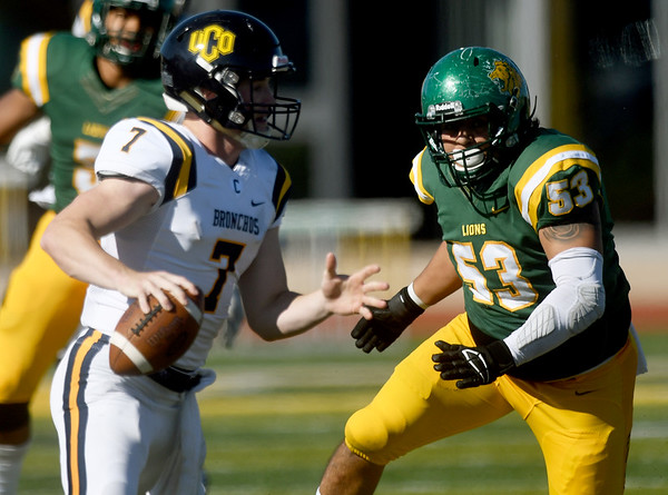 Missouri Southern's Alex Alvarado (53) pressures Central Oklahoma quarterback Will Collins (7) during their game on Saturday at Fred G. Hughes Stadium.<br /> Globe | Laurie Sisk