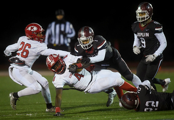 Joplin's Zach Westmoreland (1) brings down Kirkwood's Martez Jones (4) during their Class 6 District Championship game on Friday night at Junge Field. Also pictured are Joplin's James Boyd (9) and Sieon Barba (22) and Kirkwood's Cole Johnson (26).<br /> Globe | Laurie Sisk