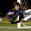 Joplin goal keeper Juan Cornelio knocks down a penalty kick in overtime during the Eagles Class 4 District 11 semifinal win over Republic on Tuesday at JHS.<br /> Globe | Laurie Sisk