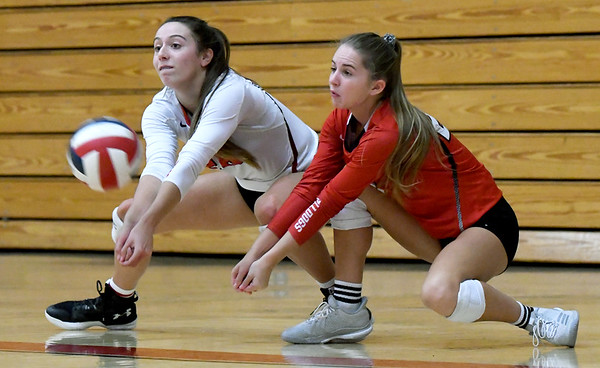 From the left: Carl Junction's Salma Lewis and Loran Dawson track down a spike during their match against Springfield Central on Saturday at the Dr. Jeffrey Knutzen CJ Classic Volleyball Tournament at CJHS.<br /> Globe | Laurie Sisk