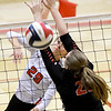 Carl Junction's Grace Southern (29) gets a spike past Central's Genevieve Thornton during their match on Saturday at the Dr. Jeffrey Knutzen CJ Classic Volleyball Tournament at CJHS.<br /> Globe   Laurie Sisk