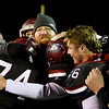 Joplin head coach Curtis Jasper gets hugs from his players after the Eagles beat Kirkwood for their Class 6 District 3 Championship on Friday night at Junge Field.<br /> Globe | Laurie Sisk