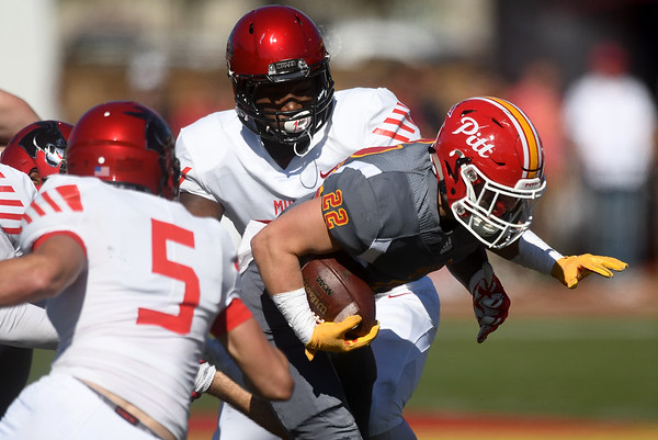 Pittsburg State's Tucker Horack (22) finds running room between Central Missouri's Dylan Albertson (5) and Javon Kirk during their game on Saturday at Carnie Smith Stadium.<br /> Globe | Laurie Sisk