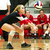Carl Junction libero Kamryn Colburn receives a serve during the Bulldogs' Class 4 District 12 Championship match against Carthage on Wednesday night at CJHS.<br /> Globe | Laurie Sisk