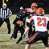 Neosho's Gage Kelly carries the ball through the Republic defense during Friday's game in Neosho.<br /> Globe | Willie Brown