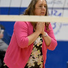 McAuley volleyball coach Amanda Walker watches from the sidelines during a game last week at McAuley.<br /> Globe | Laurie Sisk