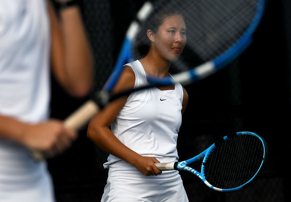 Nevada's Erika Watanaba waits for a serve on Wednesday at Millenium Tennis during a doubles match with partner Lexi Leighty against Thomas Jefferson's Jane Min and Julianna Joseph on Wednesday at Millenium Tennis.<br /> Globe   Laurie Sisk.