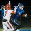 Carthage's Colton Winder pushes away Republic's Jacob Coday to score a touchdown during Friday's district game in Carthage.<br /> Globe | Roger Nomer