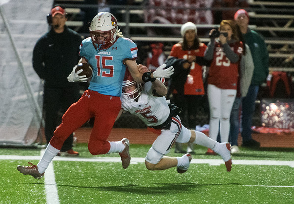 Webb City's Cale McCallister pulls in an interception and gets away from Carl Junction's Tyler White during Friday's district game in Webb City.<br /> Globe | Roger Nomer