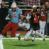 Webb City's Cale McCallister pulls in an interception and gets away from Carl Junction's Tyler White during Friday's district game in Webb City.<br /> Globe   Roger Nomer