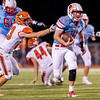 Globe | Israel Perez<br /> Webb City's Quarterback Cade Beason (14) runs the ball with a gain of yards as he gets past Nolan White (23) of Republic during their game on Friday night at Cardinal Stadium.