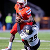 Cardinal's Durand Henderson (7) runs the ball as he fights the tackle of Neosho's Cade Lyeria during their Class 4 District 6 Championship game on Friday night at Cardinal Stadium.<br /> Globe|Israel Perez