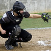McDonald County catcher Kylie Helm mans the plate during the Mustangs' sectional game against Bolivar last week at MCHS.<br /> Globe | Laurie Sisk