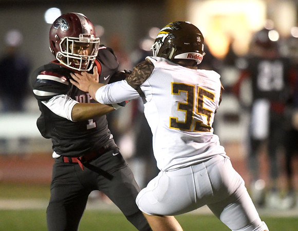 Joplin's Zach Westmoreland (1) shakes off the tackle of Kickapoo's Evan Brage (35) during their game on Friday night at Junge Stadium.<br /> Globe | Laurie Sisk