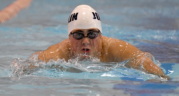 Joplin's Avery Oehlschlager swims the breast stroke leg of the 200 yard medley relay on Thursday during the COC Invitational at Webb City. Joplin placed first in the event.<br /> Globe | Laurie Sisk