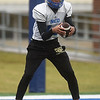 Northeastern Oklahoma A&M quarterback Guy Myers (14) warms up with receivers during practice on Wednesday at NEO.<br /> Globe   Laurie Sisk
